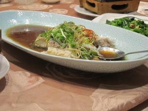 Steamed live fish with slivers of ginger and green onion