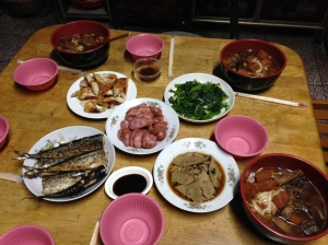 Homemade beef noodle soup with fish, fishcake, vegetables, liver and sausage.