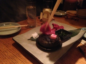 Thin slices of steak grilled tableside on a hot rock.