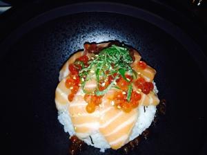 Salmon sashimi with roe over rice
