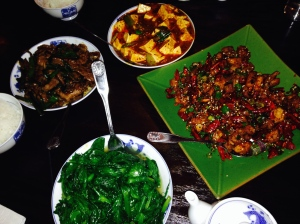 From the top: Mapo tofu, Sichuan fried chicken, stir fried snow pea shoots, sauteed lamb.