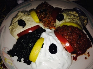 Meze platter: (from top towards the right) tomato based tabouleh, baba ghanoush, ?, yogurt, sauteed spinach, hummus